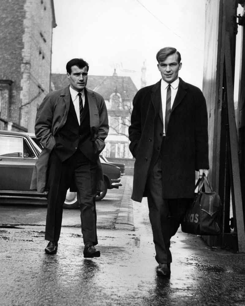 Team-mates Phil Chisnall, left, and Ian Ross on their way to play Ajax Amsterdam in the second round of the 1967 European Cup. Ajax won 5-1 and drew the return leg at Anfield 2-2