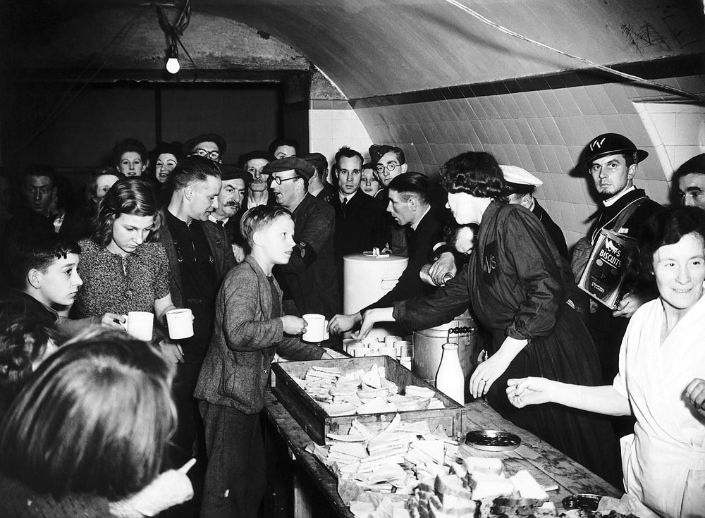 Tea and sandwiches provided by the Women's Voluntary Service in a Liverpool shelter, October 1940