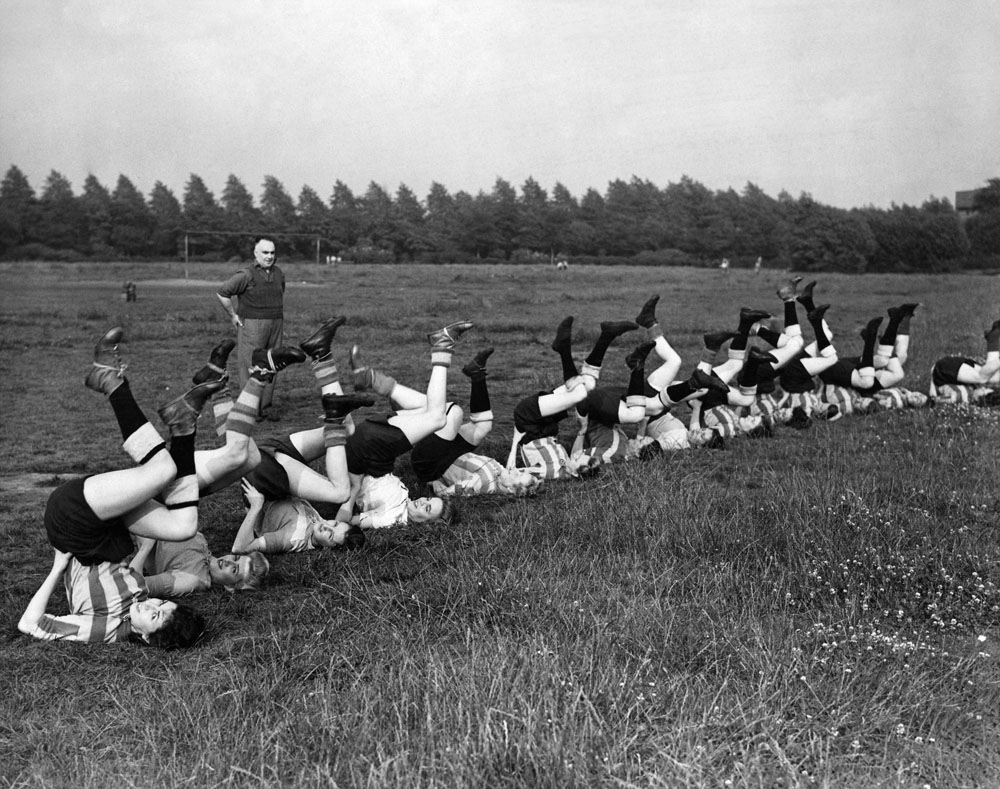 Women workers from the Fairey Aircraft company train for a football match, July 1944