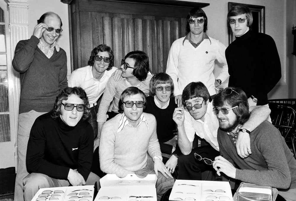 England players try on their sunglasses, April 1975