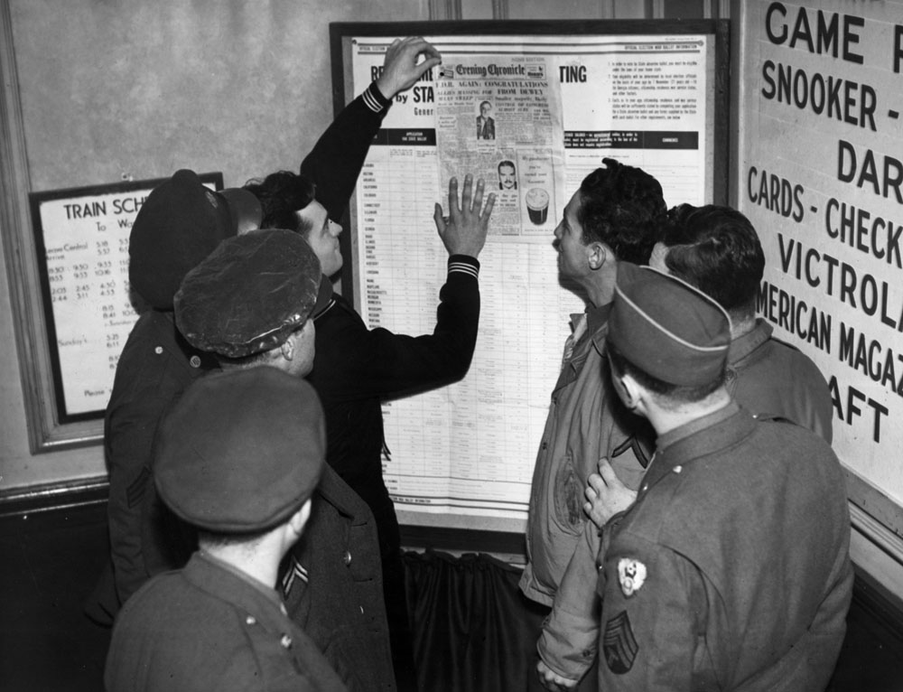 American soldiers catch up with election news at their Manchester base, November 1944