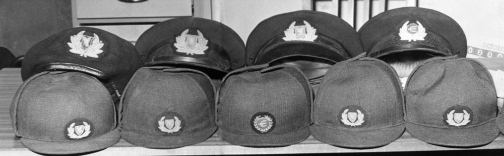 Surplus hostesses' hats and pilots' caps lined up at Speke airport, November 1968