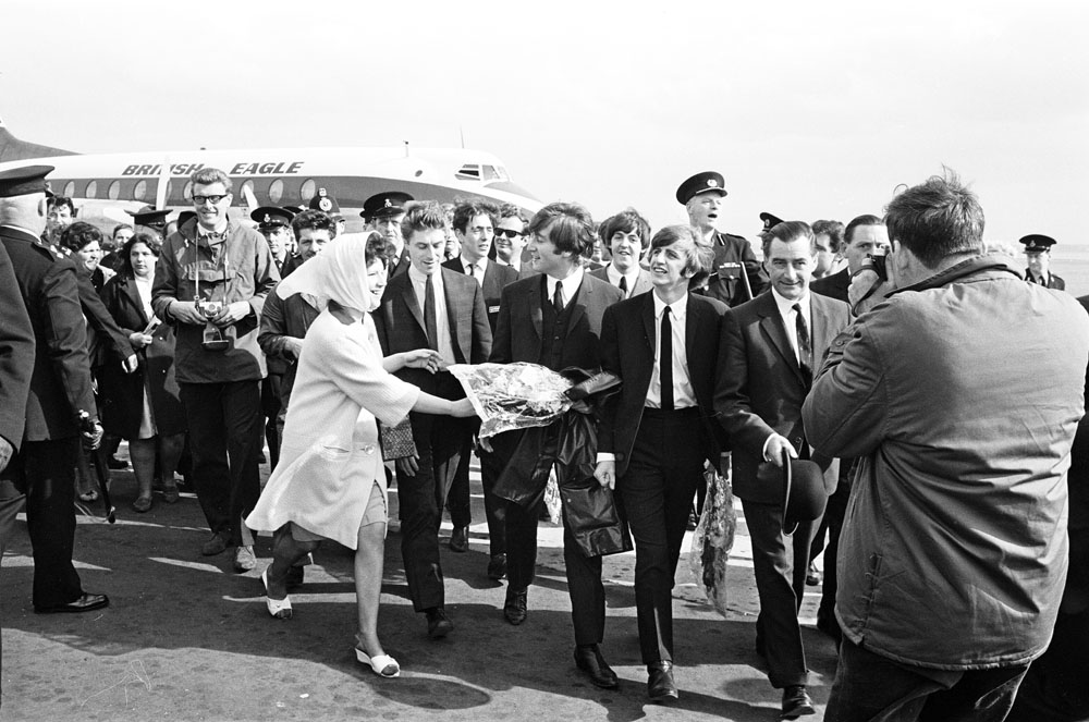 The Beatles fly British Eagle to the Liverpool premiere of their film A Hard Day's Night, July 1964