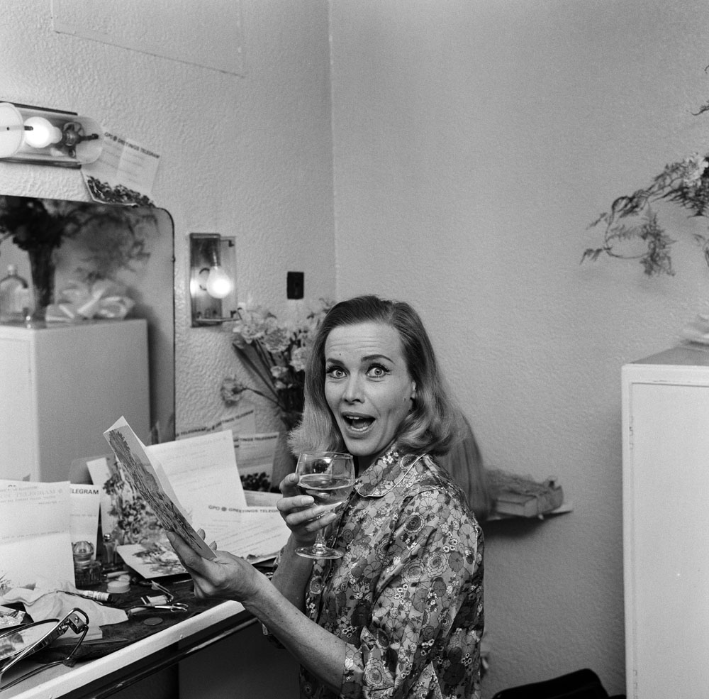 Honor Blackman opens a telegram from Noel Coward at the Palace Theatre, November 1968