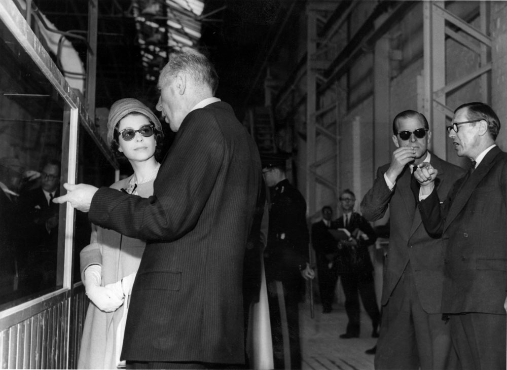 The Royal couple wear anti-glare spectacles on their visit to Pilkington Glassworks, May 1961