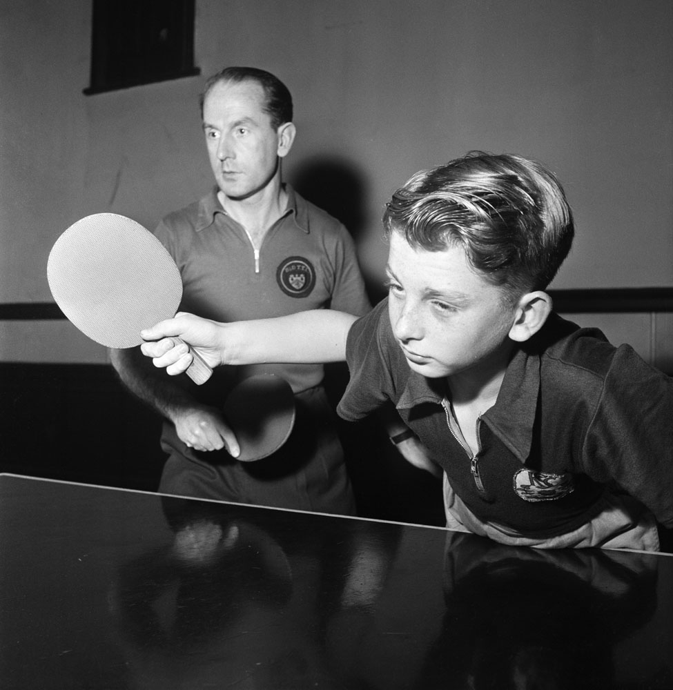 Table tennis doubles father & son practise before championships