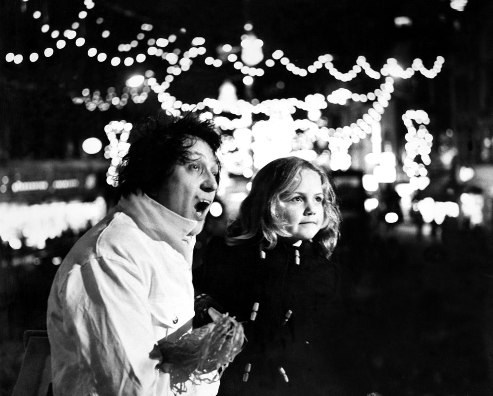 Ken Dodd switches on the Christmas lights with Paula Clee, 6, from Toxteth, November 1969