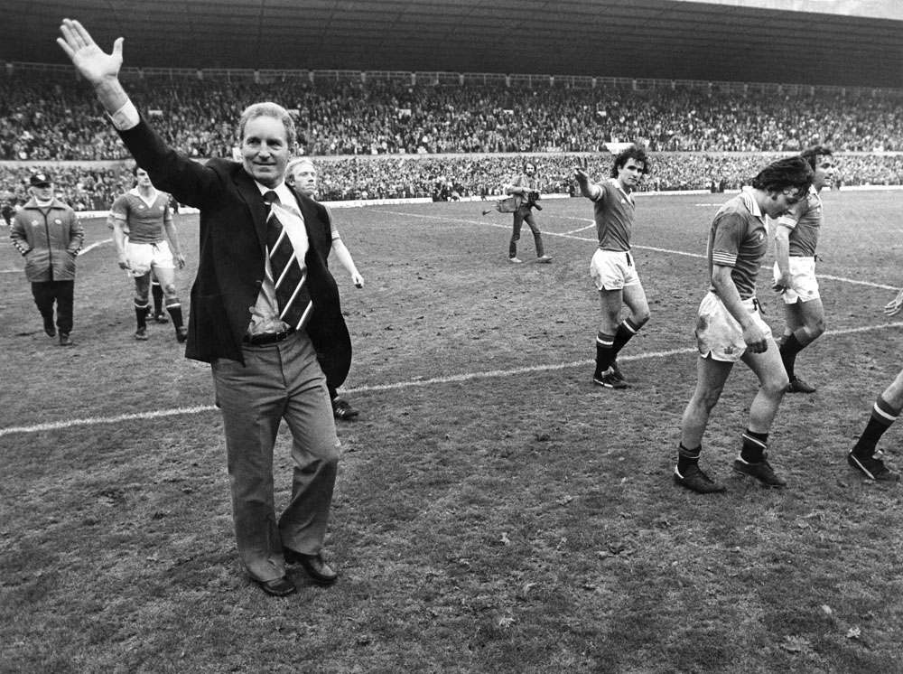 Manager Dave Sexton waves to the crowd with his United team, May 1979