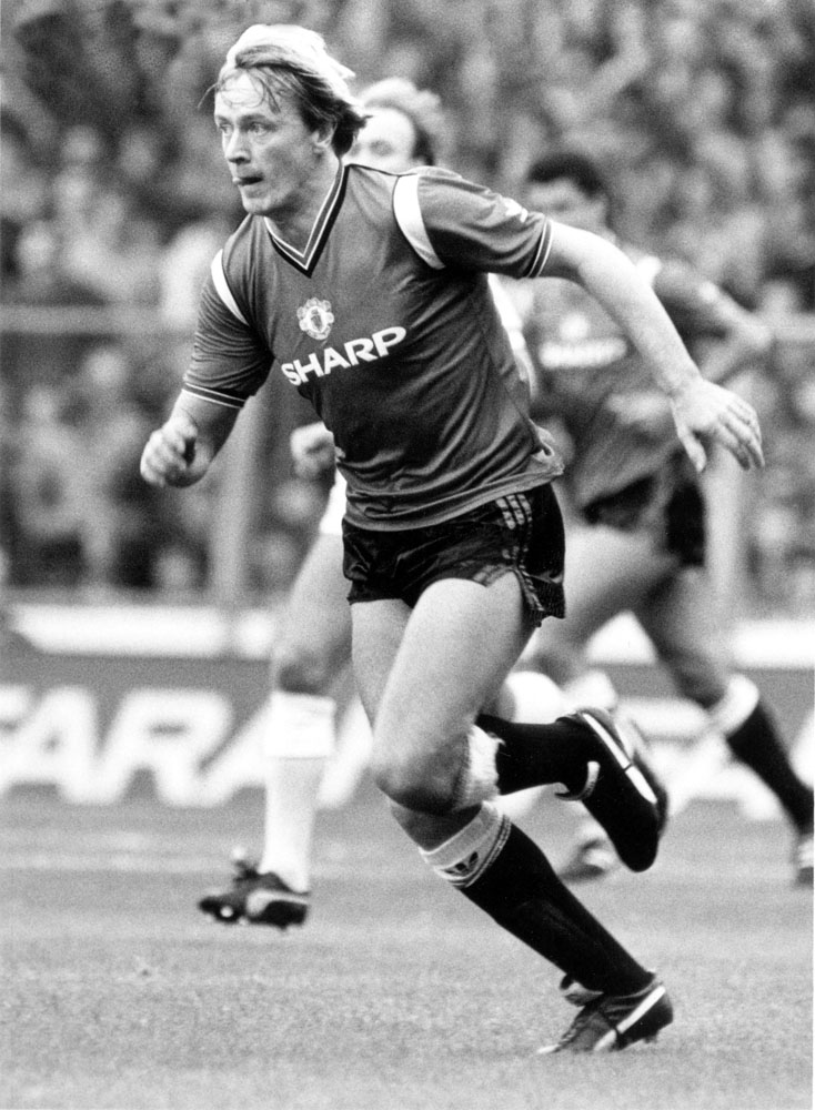 Peter Barnes in action for United in their 3-0 win against City, September 1985