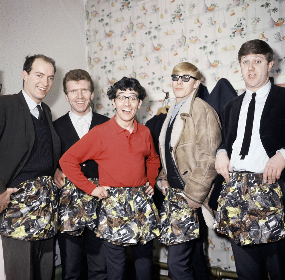 Freddie and the Dreamers pose with swimming trunks presented by their manager, January 1964