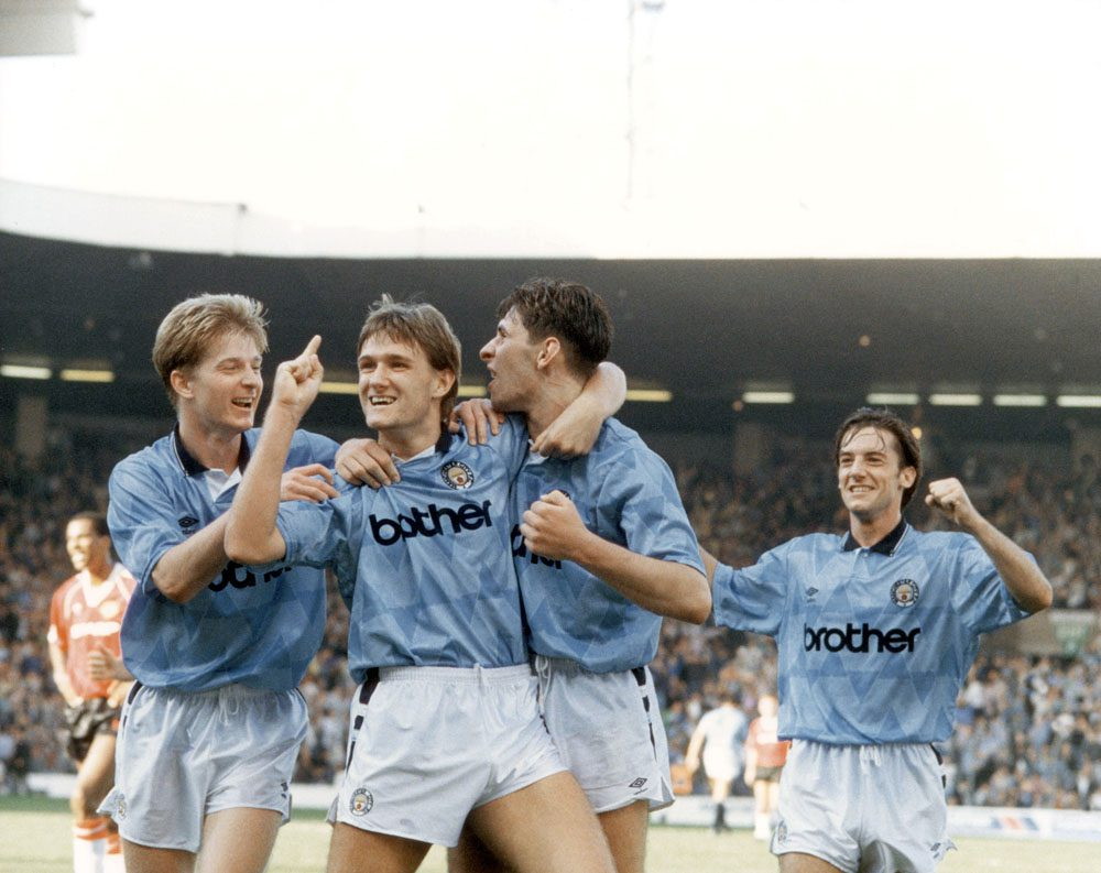 Andy Hinchcliffe celebrates City's 5-1 win over United with, from left, Ian Brightwell, Paul Lake and Ian Bishop, September 1989