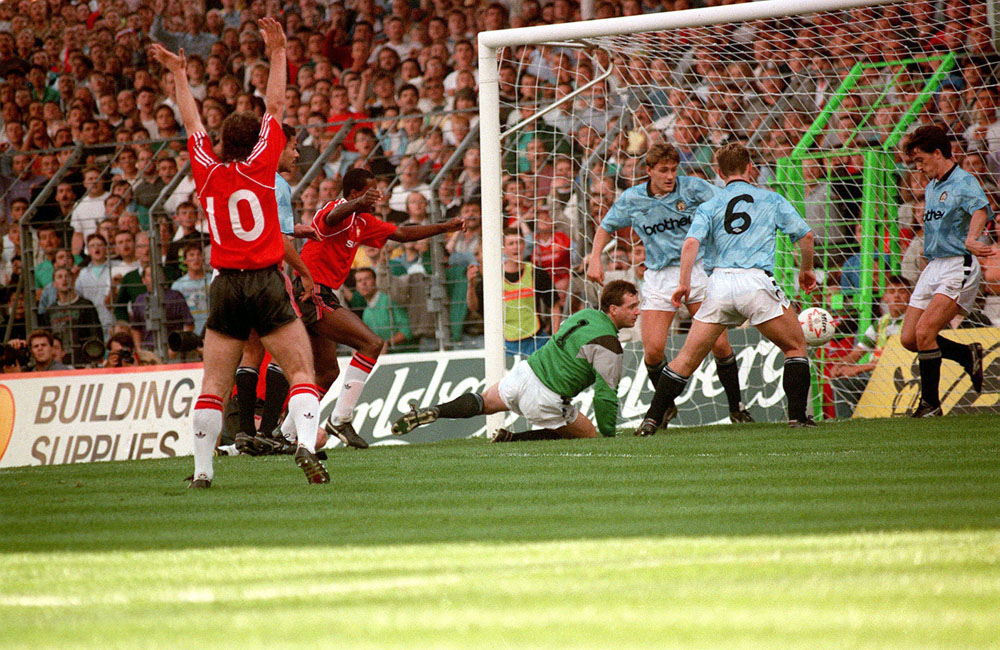 Mark Hughes scores United's only goal in the 5-1 defeat by City, September 1989