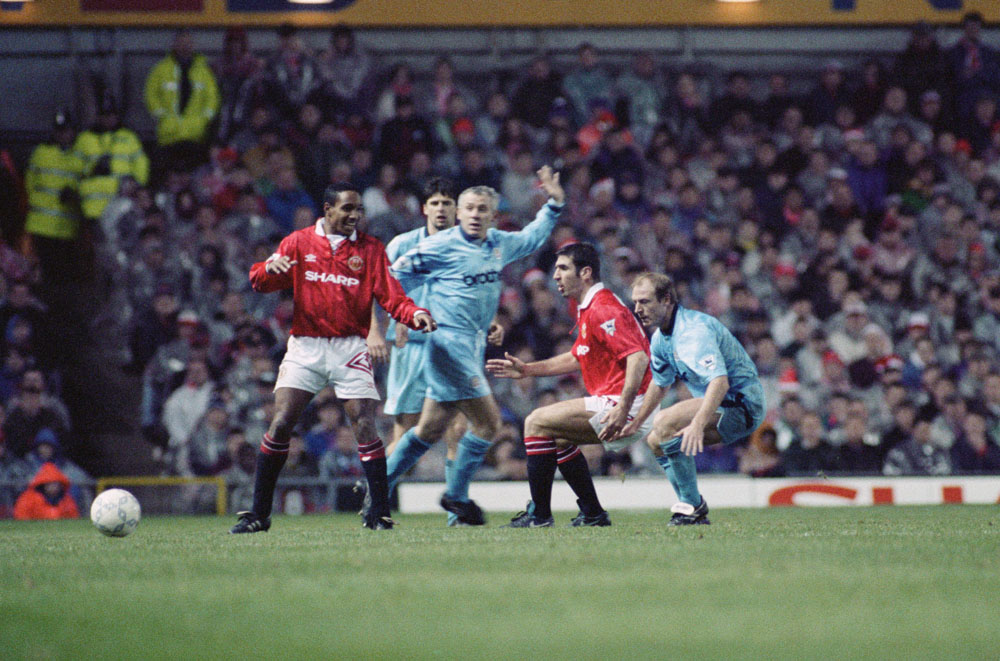 Eric Cantona makes his United debut with team-mate Paul Ince and City players Niall Quinn, Peter Reid and Steve McMahon, December 1992