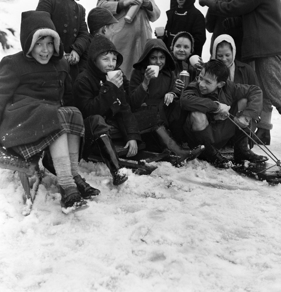 Children from St Luke's Primary School enjoy the snow, January 1959