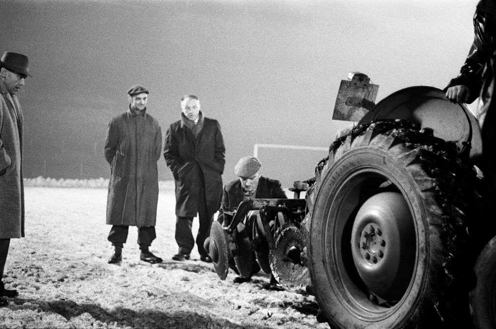 Liverpool manager Bill Shankly calls in a tractor to clear the Anfield pitch, January 1963