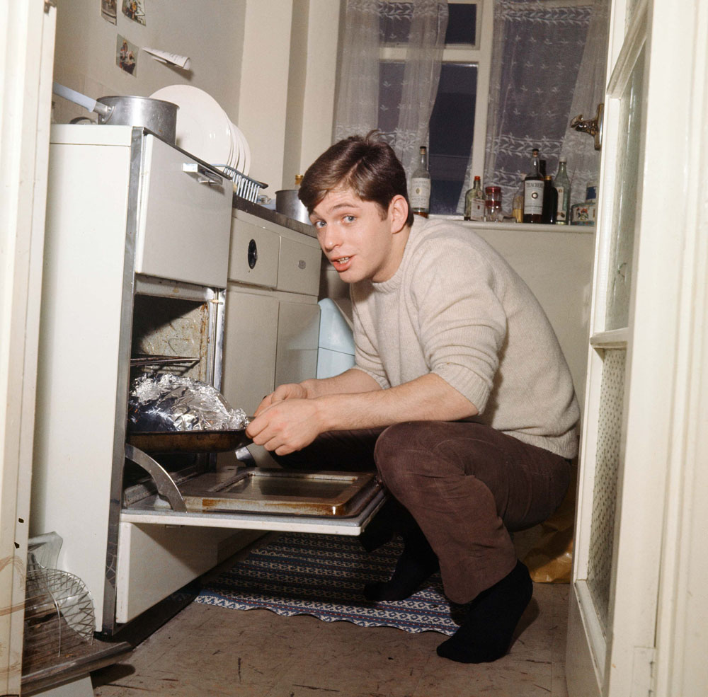 Domestic bliss! Georgie Fame cooking at home, January 1965