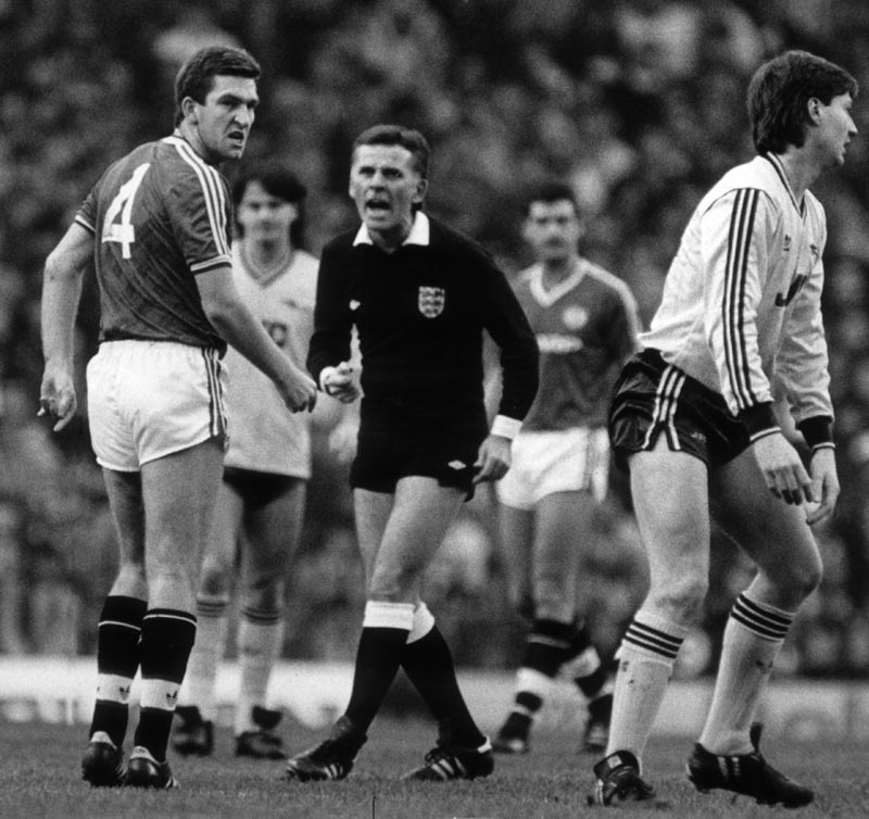 Norman Whiteside stares in anger after clashing with Arsenal's David Rocastle, January 1987