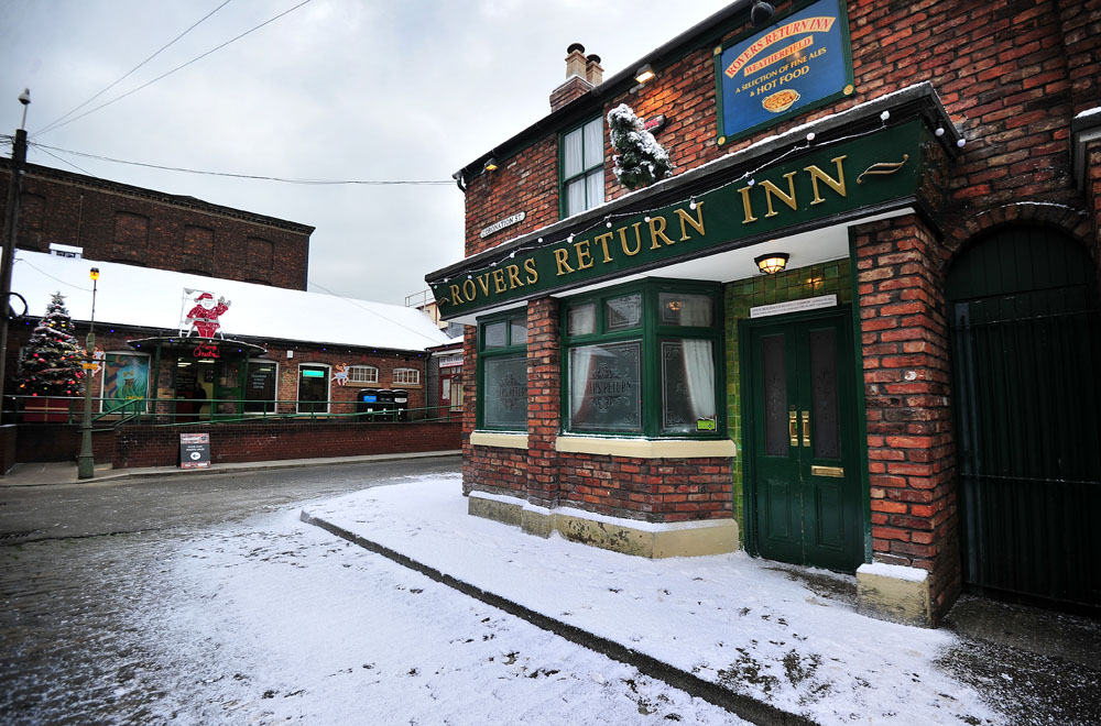The Rovers Return gets a dusting of snow on the Coronation Street set, November 2014
