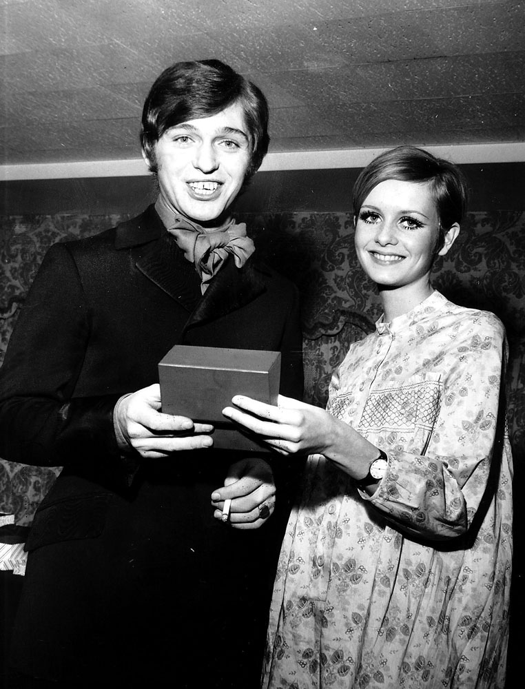 Model Twiggy presents Georgie Fame with a Personality of the Year award, January 1960