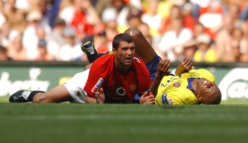 Roy Keane tangles with Arsenal's Patrick Vieira in the Charity Shield, August 2003