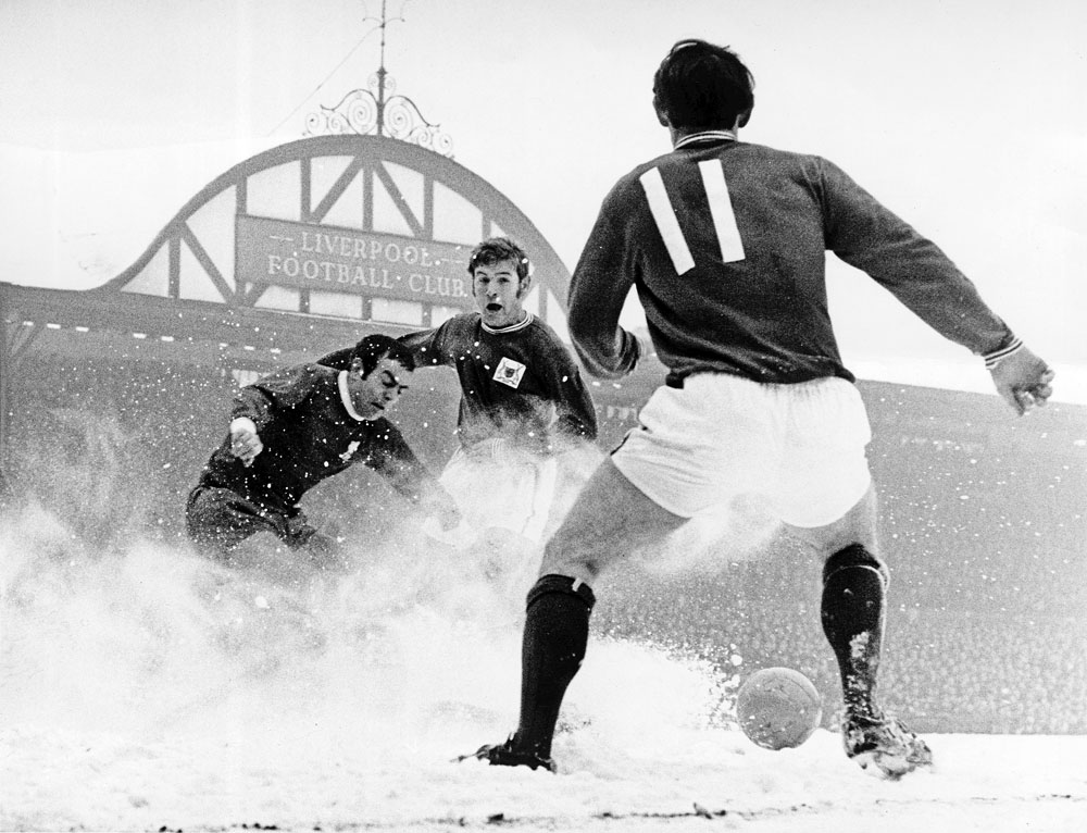 Ian St John kicks up some snow as Liverpool play Nottingham Forest, February 1969