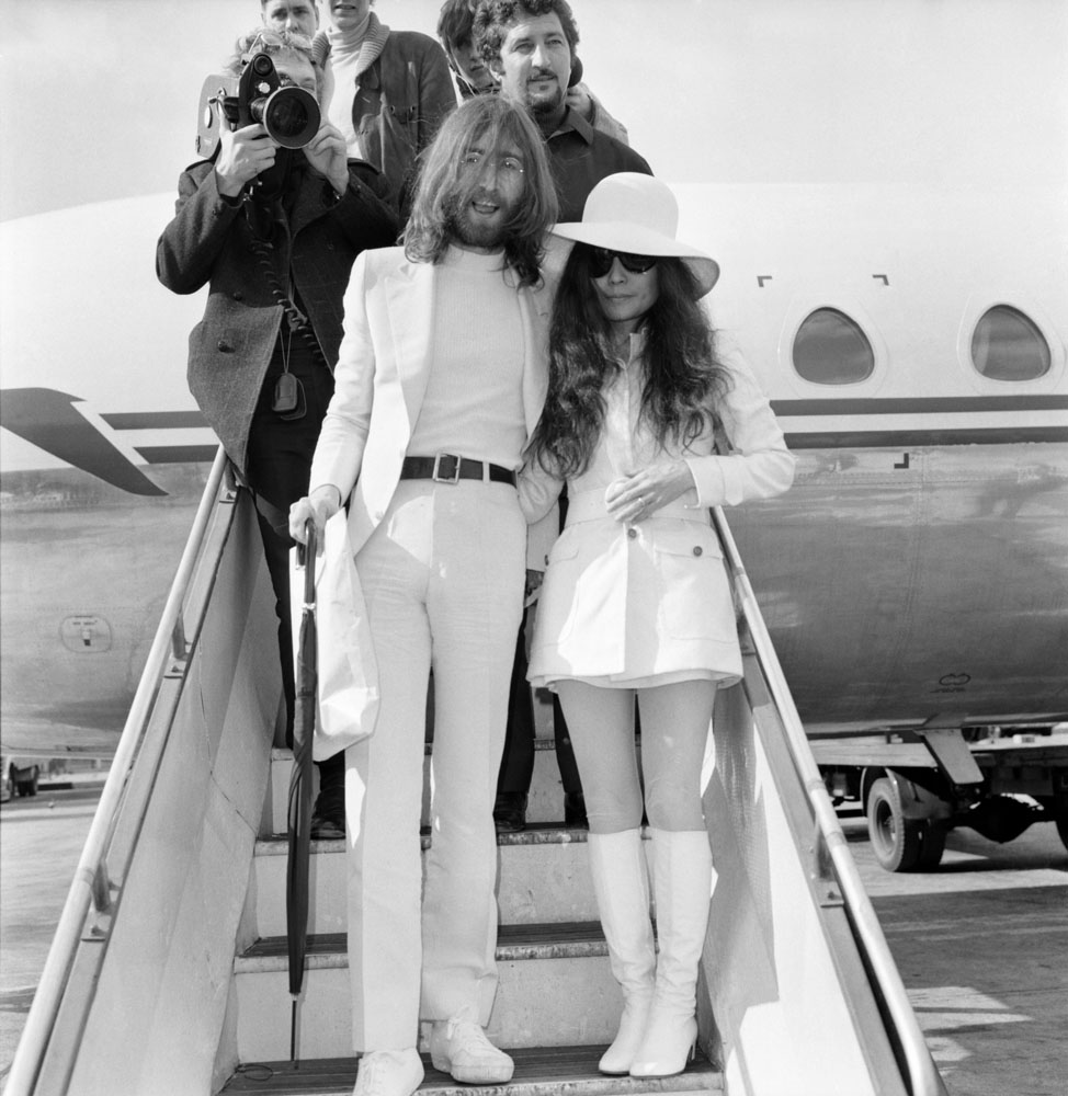 Newlyweds John Lennon and Yoko Ono at Amsterdam airport before their Bed-In, March 1969