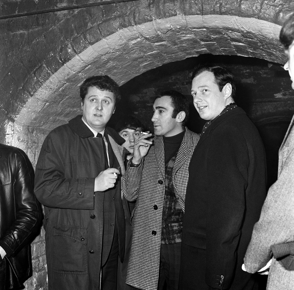 Lionel Bart, centre, and Brian Epstein, right, at the Cavern Club, January 1964