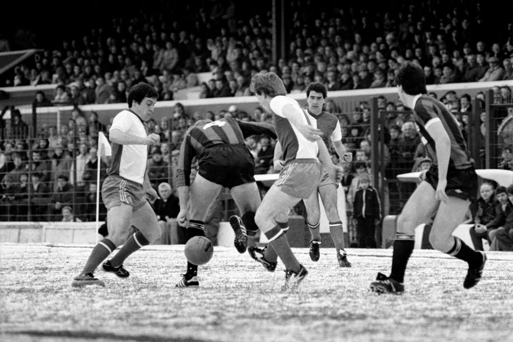 Manchester City take on Blackburn Rovers on an icy pitch, January 1984