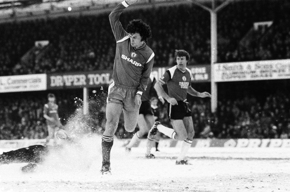 Manchester United's Mark Hughes kicks up a flurry of snow against Southampton, March 1986