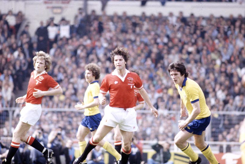United's Martin Buchan, centre, thwarts Arsenal's Frank Stapleton in the 1979 FA Cup Final