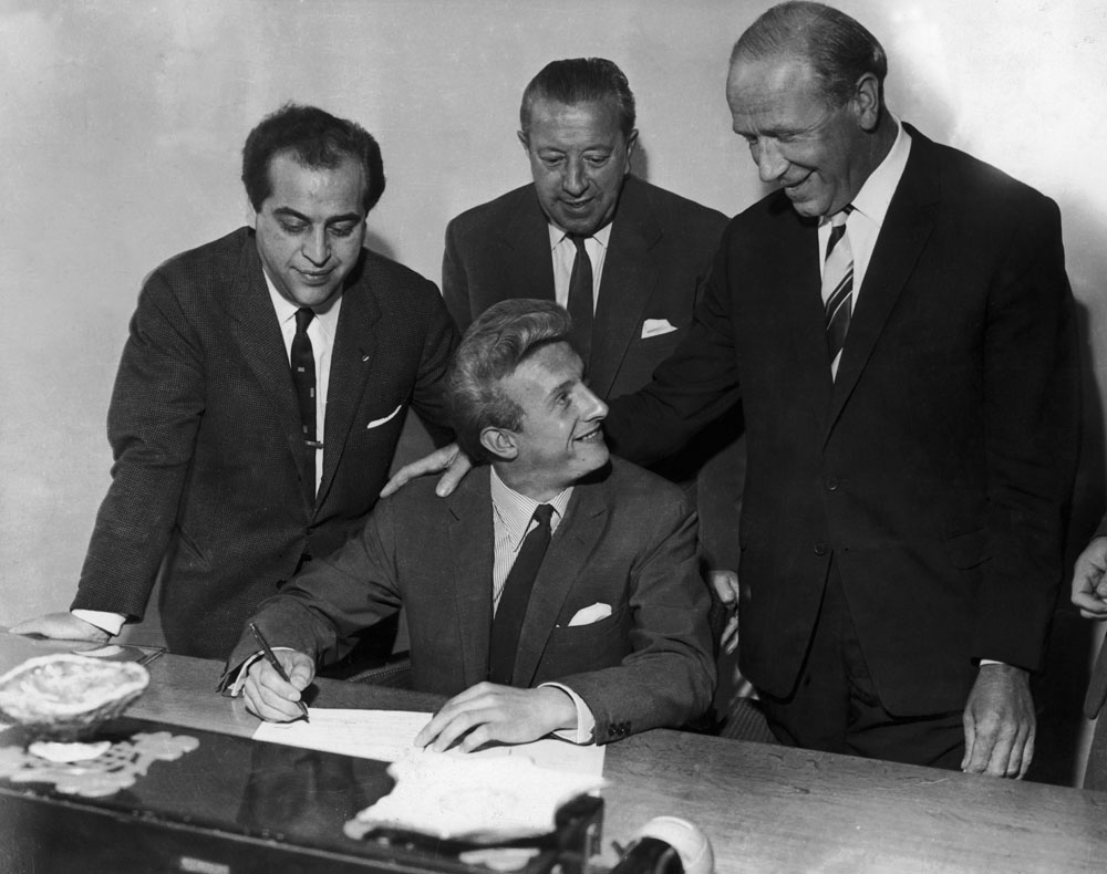 Manager Matt Busby looks on as Denis Law signs for Manchester United, July 1962