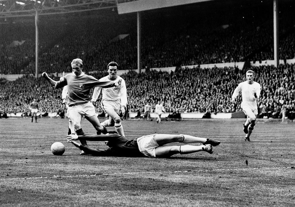 Leicester 'keeper Gordon Banks dives at Denis Law's feet in the FA Cup Final, May 1963