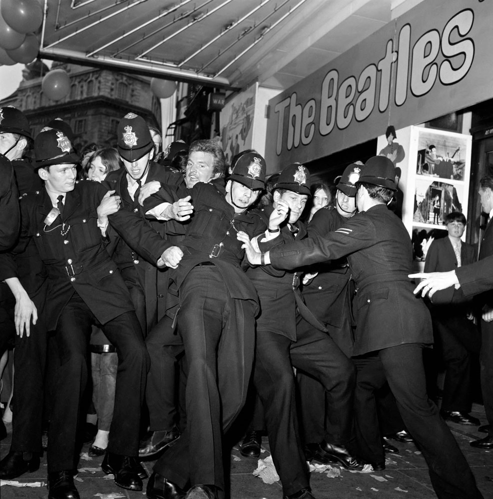 Police hold back fans at premiere of Yellow Submarine, July 1968