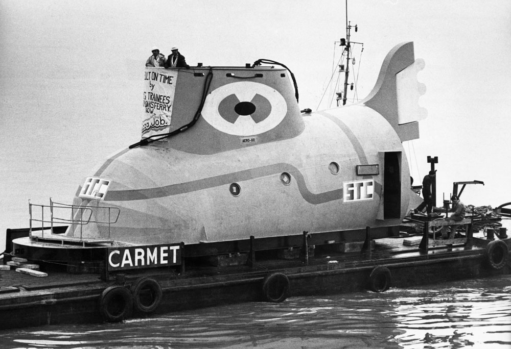 The completed Yellow Submarine is floated down the Mersey to the festival site, February 1984