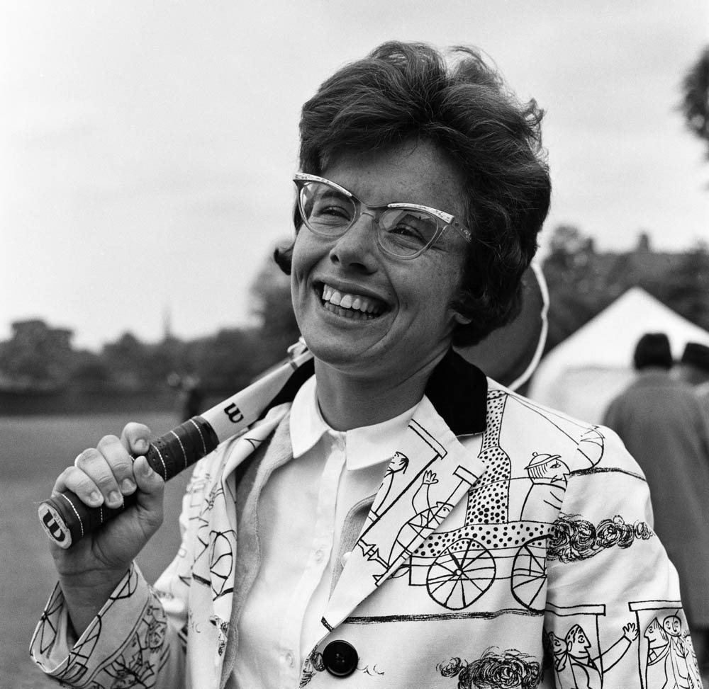 Smiling through the rain - Billie Jean King at the Northern Tennis Tournament at Didsbury, June 1964