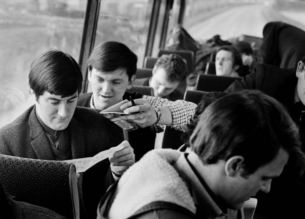 The Fourmost relax on their tour bus, February 1965