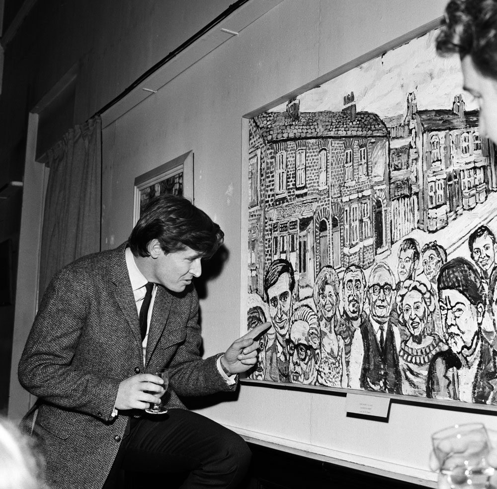 William Roache takes a close look at his mural likeness, February 1966
