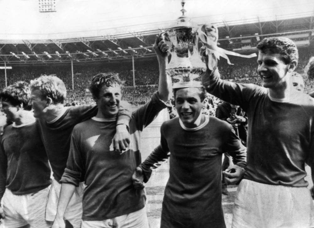 Two-goal hero Mike Trebilcock is crowned by his team-mates after winning the FA Cup, May 1966