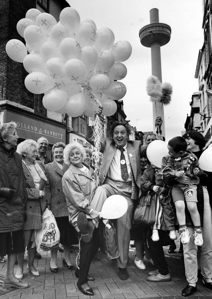 Ken Dodd releases balloons for the Red Cross with the tower in background, April 1993