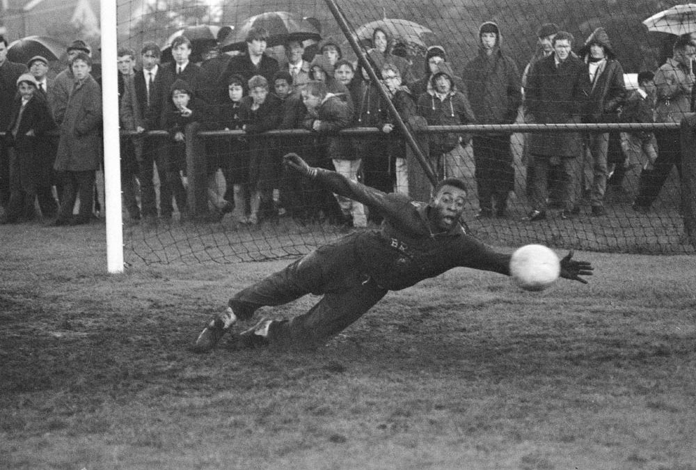 Pele makes a fine save in the mud at Bolton's training pitch, July 1966