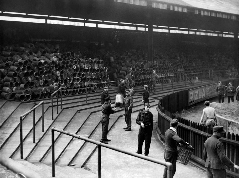 German PoWs clear baskets from Bolton's stand before the wartime cup final, May 1945
