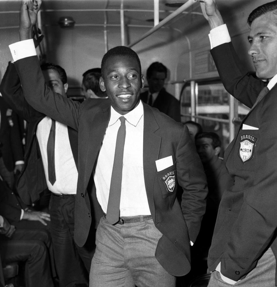 Pele strap-hanging on an airport bus, June 1966