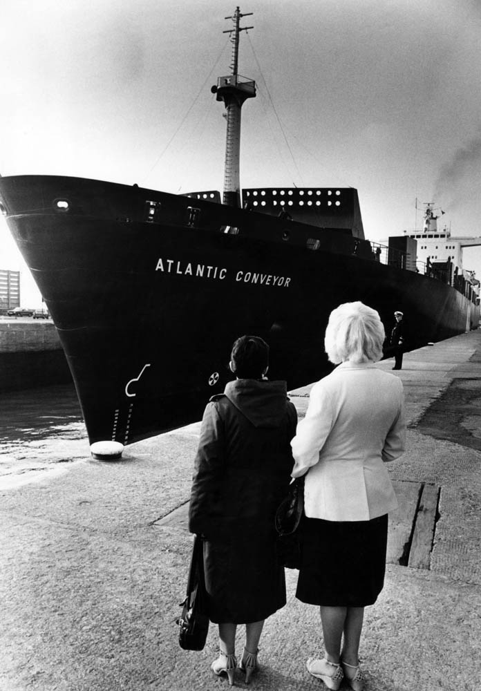 Wives watch as their husbands sail to war on the Atlantic Conveyor, April 1982