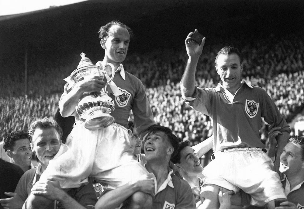 Stanley Matthews lifts the FA Cup after Blackpool beat Bolton 4-3, May 1953