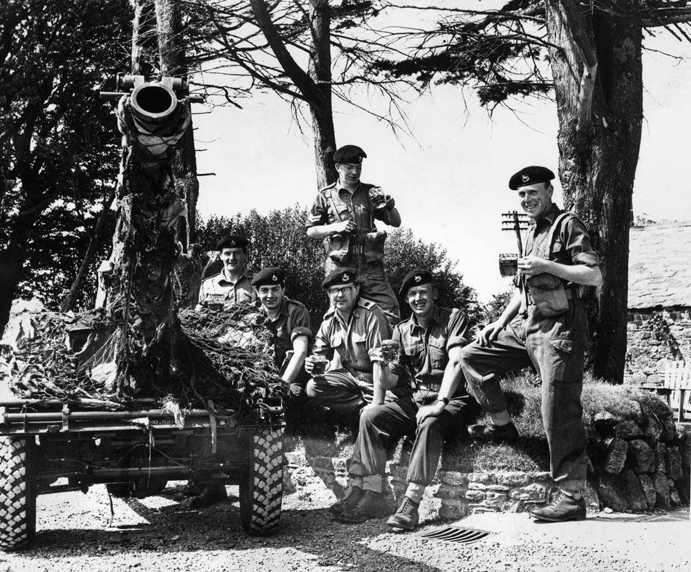 Troops celebrate with a pint after breaking the record time for a gun drill, June 1966