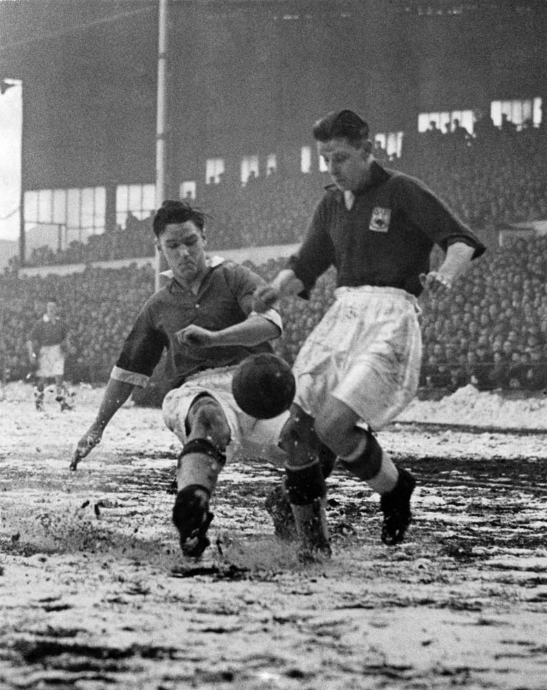 Bolton's Johnny Wheeler, left, wins the ball in the 1-0 FA Cup tie victory over Luton, February 1953