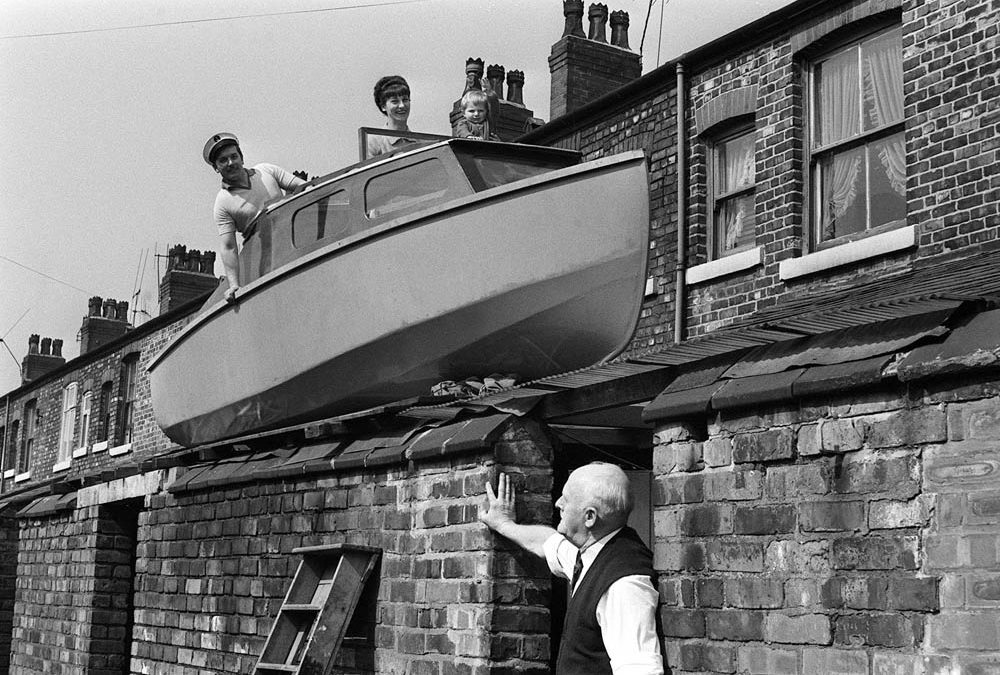 Man Builds Boat on Roof