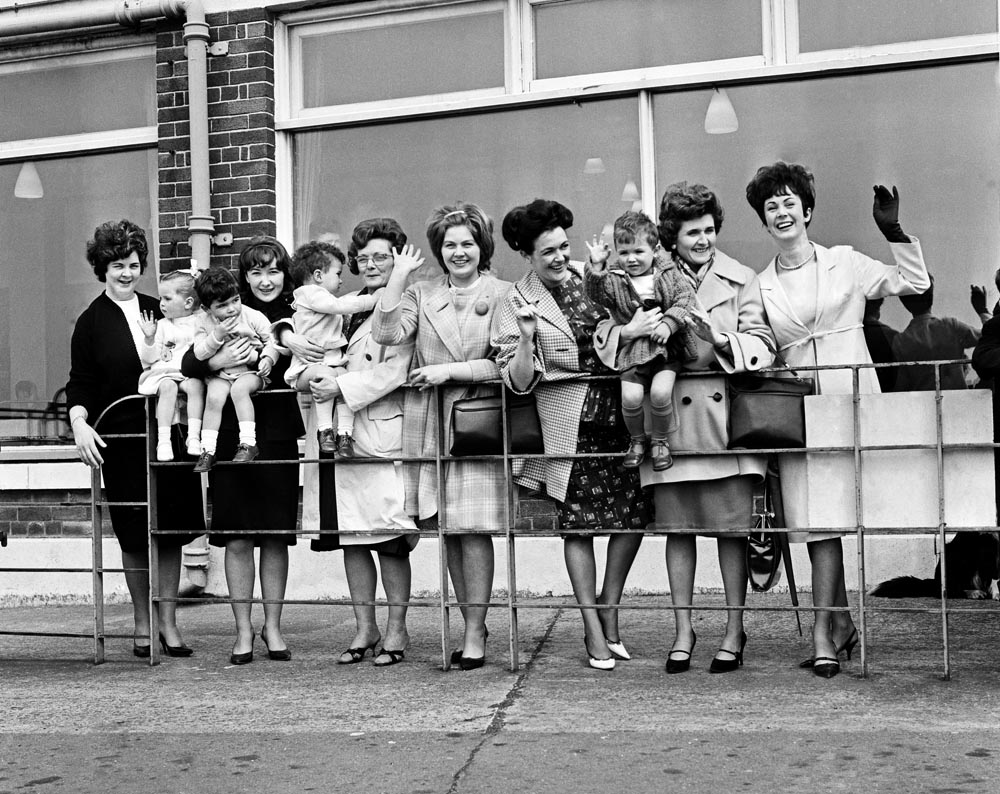 Wives and girlfriends wave goodbye to the Everton team from the Speke Airport terminal, April 1964