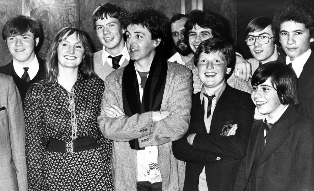 Paul McCartney meets pupils from his old school, the Liverpool Institute, after appearing at the Royal Court Theatre, November 1979