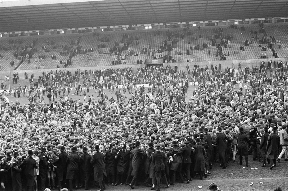 Police keep the crowds at bay at United's last match of the season, May 1969